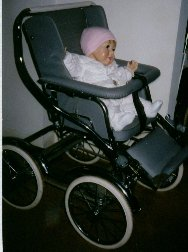 Photo of Emma in Babyhood stroller with handle folded back.